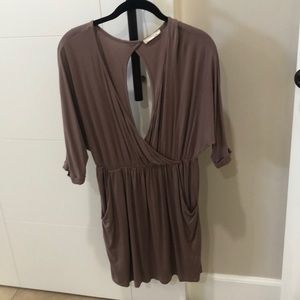 Low cut tan dress. open back with pockets.